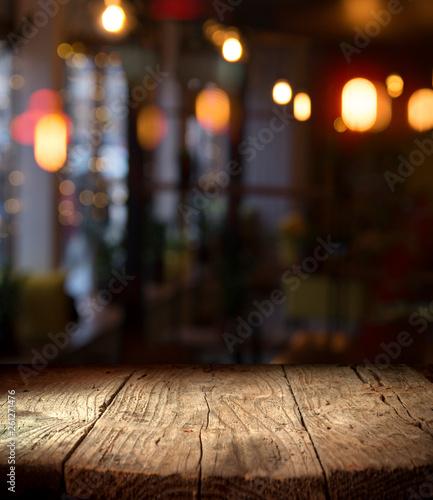 Fotografie, Obraz  blurred background of bar and dark brown desk space of retro wood