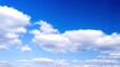 Time-lapse footage of blue sky full of white clouds during a cloudy summer day. White puffy clouds on the blue sky background.