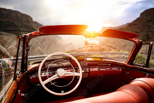 Cadres-photo bureau Vintage voitures Summer car on road and sunset time in mountains.