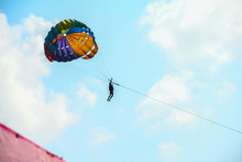 People Flying On Parachute Ride In Air Flight ,background Blue Sky Travel Summer Vacation Tourism