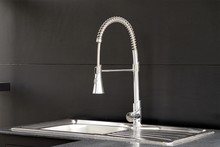 Modern Kitchen Faucet On Black Background.