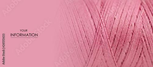 Fotografija Pink thread macro background clothing sewing material pattern