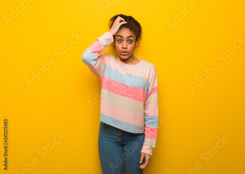 Young black african american girl with blue eyes worried and overwhelmed Wallpaper Mural