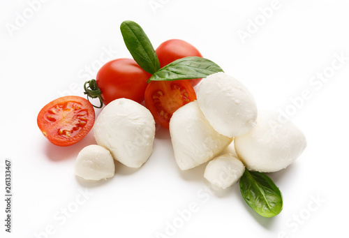 Fototapeta Mozzarella, tomatoes and basil on white. obraz