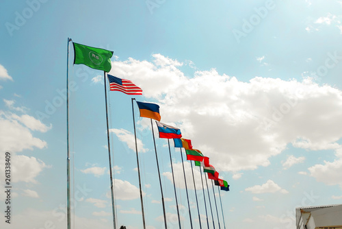 flags of nato international countries in afghanistan against sky Canvas Print
