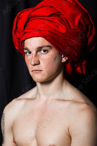 Fotografia Man with naked torso in red turban in studio