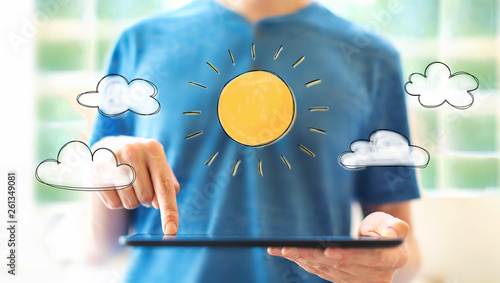 Fotografia  Sunny day with young man using a tablet computer
