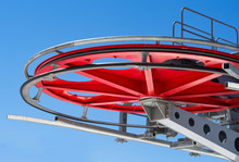 Red Pulley Wheel Or Sheave At Blue Sky Background