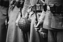 Re-enactors Dressed As World War II German Wehrmacht, Soldiers Standing Order With Rifle Weapons In Hands. Photo In Black And White Colors. Soldiers Holding Weapon Rifles