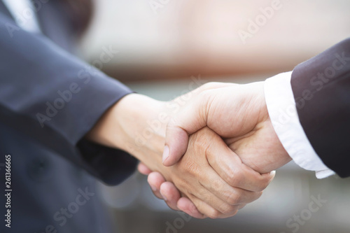 Fototapety, obrazy: Closeup of a businessman hand shake businesswoman between two colleagues  OK, succeed in business Holding hands.
