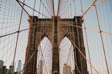 Perspective View Of Beautiful Bridge Gates With Cables On Background Of New York City