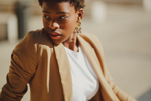 Charming Confident African American Elegant Woman With Earrings On Street On Blurred Background