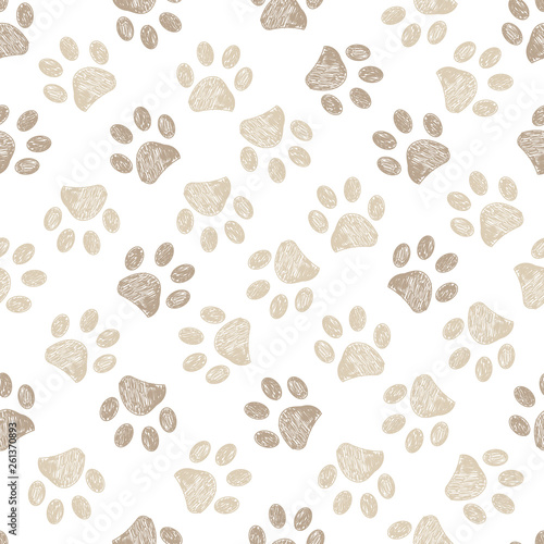 obraz lub plakat Seamless pattern for textile design. Seamless light brown colored paw print background