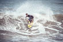 Man On Surfing On Ocean Wave