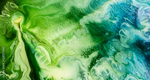 Deurstickers Kristallen Beautiful abstraction of liquid paints in slow blending flow mixing together gently