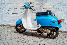 Blue Retro Scooter Parked On City Street