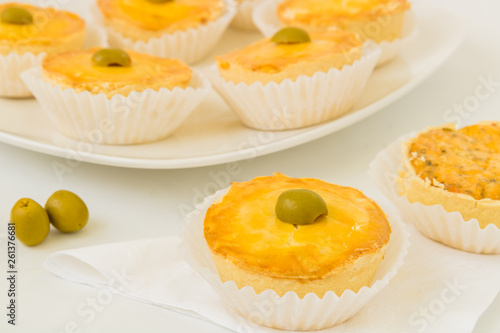 Fotografie, Obraz  Small brazilian chicken pies are set on a white background - Close-up