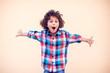 Leinwandbild Motiv Young boy kid shows hugs with open arms