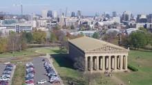 Aerial Approach Nashville Parthenon, City Skyline Background.
