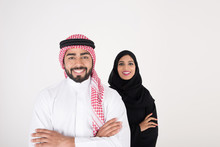 Arab Couple Smiling And Standi...