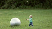 Funny Little Blond Baby Playin...