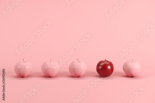 Outstanding red apple among pink painted apples on pastel pink background. Minimal fruit idea concept. - 261412666
