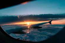 Airplane Flight At Sunset