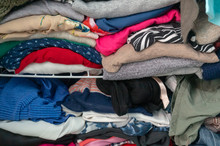 Messy Folded Clothes Crammed I...