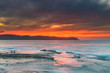 Soft High Cloud and Orange Burst Sunrise Seascape