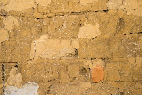 Wall Murals Old dirty textured wall Adobe brick wall with worn-off plaster