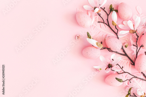 Tuinposter Magnolia Easter composition. Easter eggs, pink flowers on pastel pink background. Flat lay, top view, copy space