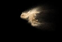 Sand Explosion Isolated On Black Background. Freeze Motion Of Sandy Dust Splashing.