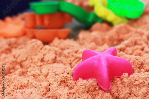 Photo  Sandbox Children's playground, artificial sand, there are many toys
