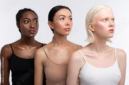 Fotografie, Obraz Three women with different skin color wearing camisoles