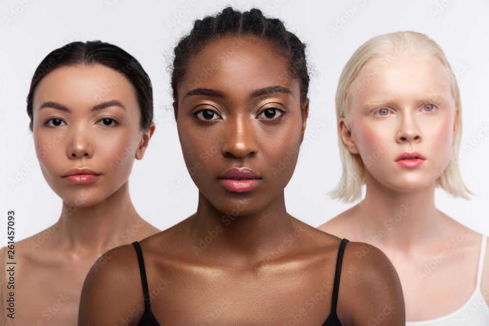 Fototapety, obrazy: Three women with different complexion posing together