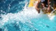 Child jumping into inflatable mattress at the swimming pool water