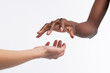 canvas print picture - Dark-skinned woman holding her hand above white hand