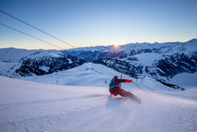 Ski Sport Man On Winter Ski Track. Colorful Sunrise In Background.