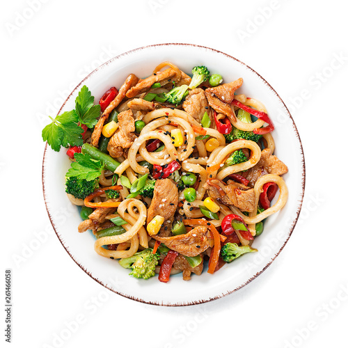 Slika na platnu Udon stir fry noodles with pork meat and vegetables in a white plate isolated on white  background