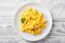 Scrambled Eggs On White Plate ...