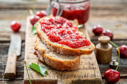 Closeup of fruity sandwich with fresh cherry jam Canvas Print