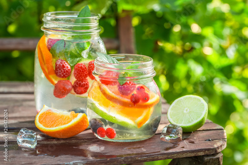Healthy lemonade with mix of citrus in sunny day