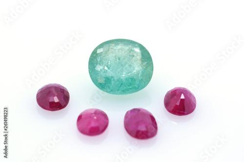 Fotografie, Obraz  Great blue polished precious paraiba surrounded by red precious stones