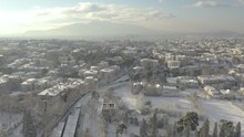 Aerial View Of Kifisia Train Line, Neighborhood Covered In Freshly Fallen Snow