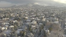 Fresh Snow On Kifisia Neighborhood, Beautiful Winter Wonderland In Athens, Aerial Pan