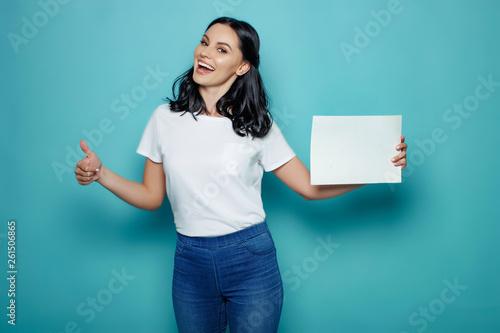 Woman holding white sheet Fototapet