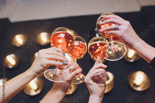 Fototapeta Close up image of woman hands with stylish manicure holding glasses with champagne , black and white style, party time. Cheers. obraz na płótnie