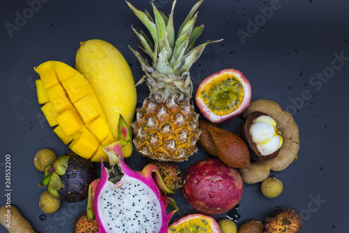 fresh exotic fruits on a black background