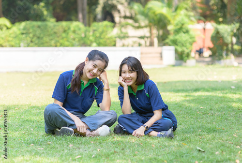 In de dag Kamperen Happy cute students smile and sitting on grass