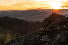 With Smoke In The Air The Sun Is Setting Over The Pennines Near Pateley Bridge Close To Brimham Rocks